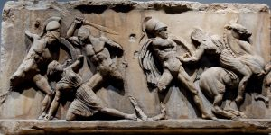Greek art of five men battling in ancient Greece.